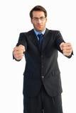 Επιχειρηματίας που στέκεται με τις σφιγγμένες πυγμές Στοκ Εικόνα