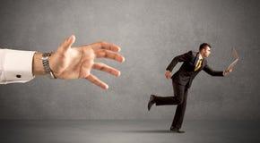 Επιχειρηματίας που τρέχει από το χέρι Στοκ εικόνα με δικαίωμα ελεύθερης χρήσης