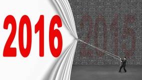 Επιχειρηματίας που τραβά κάτω την κουρτίνα του 2016 που καλύπτει το παλαιό τούβλο του 2015 wa Στοκ Εικόνες