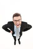 0 επιχειρηματίας που φαίνεται επάνω και που φορά τα γυαλιά στο λευκό Στοκ Φωτογραφία