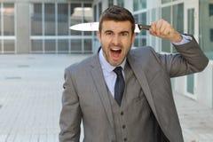 Επιχειρηματίας που φαίνεται συγκλονισμένος στο γραφείο Στοκ Φωτογραφίες