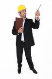Επιχειρηματίας που φορά το κράνος Στοκ φωτογραφία με δικαίωμα ελεύθερης χρήσης