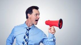 Επιχειρηματίας που φωνάζει κόκκινο megaphone Στοκ Εικόνα