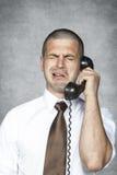 Επιχειρηματίας που φωνάζει μιλώντας στο τηλέφωνο Στοκ Εικόνες