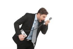 0 επιχειρηματίας που φωνάζει στο τηλέφωνο γραμμών εδάφους στο λευκό Στοκ φωτογραφίες με δικαίωμα ελεύθερης χρήσης
