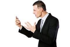 Επιχειρηματίας που φωνάζει στο τηλέφωνο κυττάρων του Στοκ Εικόνα