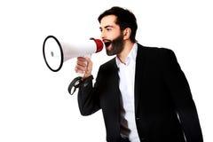 Επιχειρηματίας που φωνάζει χρησιμοποιώντας megaphone Στοκ Φωτογραφίες