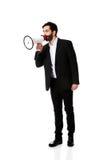 Επιχειρηματίας που φωνάζει χρησιμοποιώντας megaphone Στοκ φωτογραφία με δικαίωμα ελεύθερης χρήσης