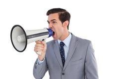 Επιχειρηματίας που φωνάζει megaphone Στοκ Φωτογραφία