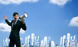 Επιχειρηματίας που φωνάζει megaphone Στοκ Φωτογραφίες