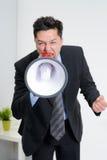 0 επιχειρηματίας που φωνάζει megaphone Στοκ Εικόνα