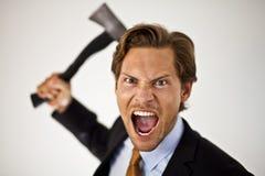 Επιχειρηματίας που χειρίζεται το τσεκούρι Στοκ φωτογραφία με δικαίωμα ελεύθερης χρήσης