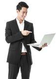 Επιχειρηματίας που χρησιμοποιεί ένα lap-top Στοκ φωτογραφία με δικαίωμα ελεύθερης χρήσης