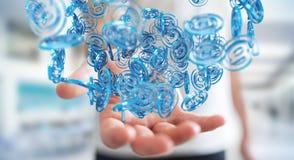 Επιχειρηματίας που χρησιμοποιεί την ψηφιακή μπλε σφαίρα arobase για να κάνει σερφ στο interne Στοκ Εικόνες