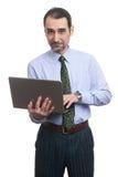 Επιχειρηματίας που χρησιμοποιεί το lap-top που απομονώνεται Στοκ Εικόνα
