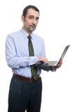 Επιχειρηματίας που χρησιμοποιεί το lap-top που απομονώνεται Στοκ Εικόνες