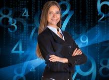 Επιχειρηματίας σε ένα κοστούμι Μπλε αριθμοί πυράκτωσης Στοκ Φωτογραφίες