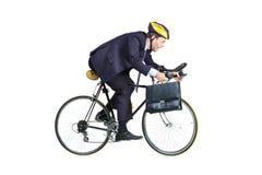 Επιχειρηματίας σε ένα κοστούμι που οδηγά ένα ποδήλατο Στοκ Εικόνες