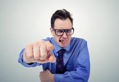 0 επιχειρηματίας στα γυαλιά που δείχνει το δάχτυλό του Στοκ Εικόνες
