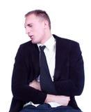 Επιχειρηματίας στον πόνο που κρατά το στομάχι του Στοκ Εικόνα
