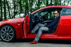 Επιχειρηματίας στο αυτοκίνητο Στοκ Εικόνες