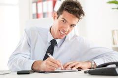 Επιχειρηματίας στο γραφείο Στοκ Εικόνα