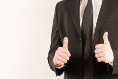 Επιχειρηματίας στο κοστούμι με τους αντίχειρες επάνω Στοκ Εικόνες