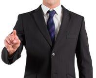 Επιχειρηματίας στο κοστούμι που δείχνει το δάχτυλο Στοκ Φωτογραφίες