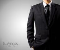 Επιχειρηματίας στο κοστούμι στο γκρίζο υπόβαθρο Στοκ εικόνες με δικαίωμα ελεύθερης χρήσης