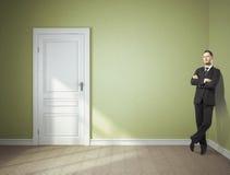 Επιχειρηματίας στο πράσινο δωμάτιο Στοκ Φωτογραφίες