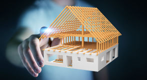 Επιχειρηματίας σχετικά με το τρισδιάστατο σπίτι σχεδίων απόδοσης ατελές με δικούς του Στοκ φωτογραφία με δικαίωμα ελεύθερης χρήσης