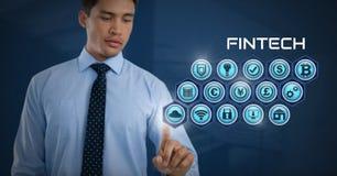 Επιχειρηματίας σχετικά με Fintech με τα διάφορα επιχειρησιακά εικονίδια Στοκ φωτογραφία με δικαίωμα ελεύθερης χρήσης