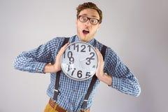 Επιχειρηματίας Geeky που κρατά ένα ρολόι Στοκ Εικόνες