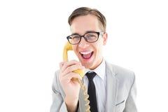 Επιχειρηματίας Geeky που μιλά στο αναδρομικό τηλέφωνο Στοκ εικόνα με δικαίωμα ελεύθερης χρήσης