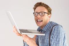 Επιχειρηματίας Geeky που χρησιμοποιεί το lap-top του Στοκ Εικόνα
