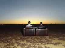 Επιχειρηματίες που κάθονται στις πολυθρόνες με το lap-top Στοκ Εικόνες