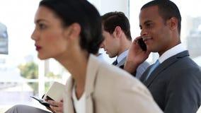 επιχειρηματίες που κάθ&omicron απόθεμα βίντεο