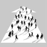 Επιχειρηματίες που κινούνται στο άσπρο βέλος Στοκ εικόνα με δικαίωμα ελεύθερης χρήσης