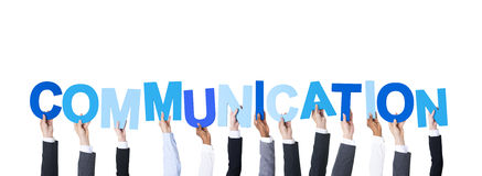 Επιχειρηματίες που κρατούν την επικοινωνία του Word Στοκ Φωτογραφία