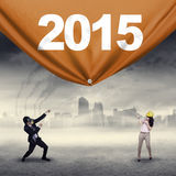Επιχειρηματίες που σέρνουν τον αριθμό 2015 Στοκ Φωτογραφία