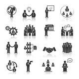 Επιχειρηματίες που συναντούν τα εικονίδια καθορισμένα Στοκ Εικόνα