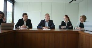 Επιχειρηματίες στην εταιρική συνεδρίαση απόθεμα βίντεο