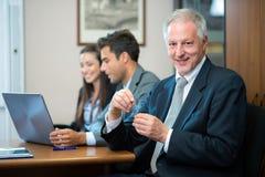 Επιχειρηματίες στο γραφείο τους Στοκ Εικόνα