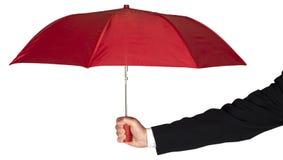 Επιχειρηματιών βραχιόνων εκμετάλλευσης ομπρέλα που απομονώνεται κόκκινη Στοκ Φωτογραφίες