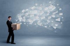 Επιχειρησιακά έγγραφα που πετούν από το κιβώτιο Στοκ Εικόνα