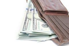 Επιχειρησιακά χρήματα δολαρίων σε ένα πορτοφόλι σε ένα άσπρο υπόβαθρο στοκ φωτογραφία
