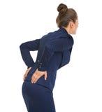 Επιχειρησιακή γυναίκα που έχει τον πόνο στην πλάτη Στοκ Εικόνες