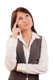 Επιχειρησιακή γυναίκα που σκέφτεται ή που κάνει την επιλογή Στοκ Φωτογραφίες