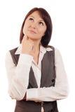 Επιχειρησιακή γυναίκα που σκέφτεται ή που κάνει την επιλογή Στοκ εικόνες με δικαίωμα ελεύθερης χρήσης