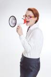 Επιχειρησιακή γυναίκα στην αρχή με το megafon στοκ εικόνα